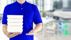 Food delivery service or order food online. Delivery man hand holding fast food packaging in blue uniform and icon symbol media on. Restaurant background stock photography