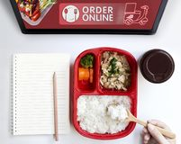 Food delivery service or order food online by motorcycle at home and icon media symbol on touch screen. Business and technology. For shopping online with stock photo