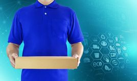 Food delivery service for order online shopping and icon media symbol. Delivery man in blue uniform hand holding paper box package. Express delivery service stock images