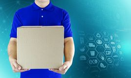 Food delivery service for order online shopping and icon media symbol. Delivery man in blue uniform hand holding paper box package. Express delivery service stock image