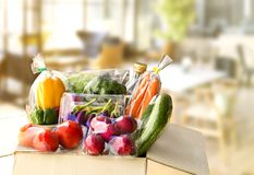 Food Delivery service: Vegetable delivery at home online order f. Or cooking and packages box with blank for text. on wooden table background Stock Images