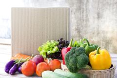 Food Delivery service: Vegetable delivery at home online order f. Or cooking and packages box with blank for text. on wooden table background Stock Photo