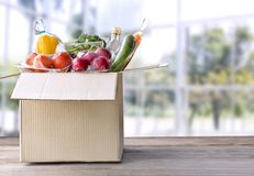 Food Delivery service: Vegetable delivery at home online order f. Or cooking and packages box with blank for text. on wooden table background.with clipping path stock photos