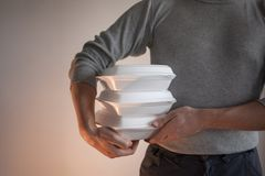 Food delivery. Delivery of tasty and healthy dishes. royalty free stock photography