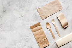 Food delivery workdesk with paper bags and flatware table background top view mock-up Stock Photos