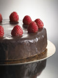 Food dessert, chocolate cake with strawberries. Sweet food dessert, chocolate cake with strawberries, on a glossy black background Stock Photo