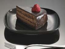 Food dessert, chocolate cake with strawberries Royalty Free Stock Photos