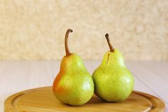 Food. Dessert. Healthy Eating. Fresh Fruits. Two Ripe Pears On A Royalty Free Stock Image