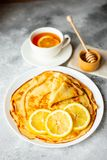 Food, dessert, pastries, pancake, pie. Tasty beautiful pancakes with banana and honey stock image