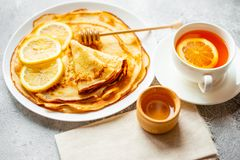 Food, dessert, pastries, pancake, pie. Tasty beautiful pancakes with banana and honey stock photo