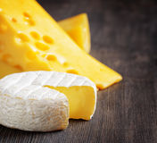 Different types of cheese on a wooden board Stock Photography