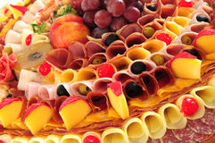 Food display. Appetizer food display, cheese, ham and fruits Stock Photo