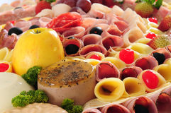Food display. Appetizer food display. Cheese, ham and fresh fruits Stock Photography