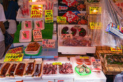 Food display of raw fish and fresh seafood on market. Tokyo, Japan - August 29, 2016: Food display of raw fish and fresh seafood on outdoor Ameyoko market, Ueno Royalty Free Stock Photos