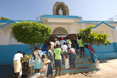 Food Distribution. September 27, 2008 - Some of the hundreds of thousands of people affected by Hurricane Ike in Gonaives, Haiti, line up to receive food Royalty Free Stock Photos