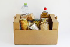 Food in a donation box. Isolated in a white background stock photos