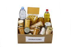 Food in a donation box. For neediness and poverty charity, isolated in a white background royalty free stock photography