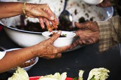 Free Food Donation To Help People In Hunger Relief Stock Photo - 121019480