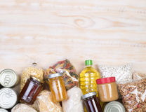 Food donations on wooden background. Top view with copy space stock image