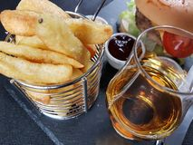 Food drink beverage burger chips chipbasket Stock Image