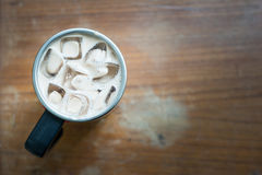 Food Drink. Close up a cup of ice coffee under brown wooden retro background Royalty Free Stock Photos