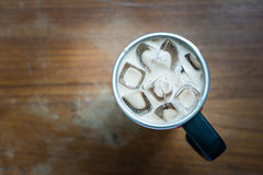 Food Drink. Close up a cup of ice coffee under brown wooden retro background Royalty Free Stock Photo