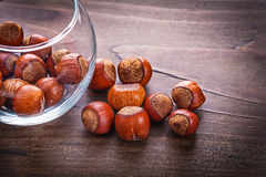 Food and drink concept stack of hazelnuts in glass Royalty Free Stock Images