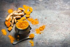 Turmeric root curcuma longa powder. Food and drink, diet nutrition, health care concept. Organic orange turmeric root and powder, curcuma longa on a grunge Royalty Free Stock Photography