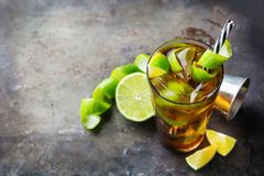 Cuba libre alcohol cocktail drink with rum, cola, ice, lime. Food and drink, holidays party concept. Alcohol cocktail with rum and cola cuba libre beverage stock photos