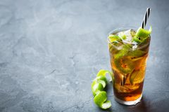 Cuba libre alcohol cocktail drink with rum, cola, ice, lime. Food and drink, holidays party concept. Alcohol cocktail with rum and cola cuba libre beverage stock photography