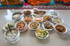 Food and drink for monks in traditional religious ceremony in a temple Stock Image