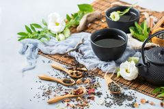 Selection of japanese chinese herbal masala tea teapot. Food and drink, still life concept. Selection assortment of different japanese chinese herbal masala tea Stock Photos