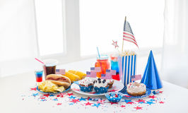 Food and drinks on american independence day party. National holidays, celebration, food and patriotism concept - close up of hot dog with american flag Royalty Free Stock Photo