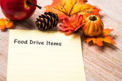 Food Drive concept. Food Drive list concept on notebook and wooden board Stock Images