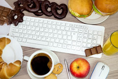 Food we eat during work. Concept bed habit Royalty Free Stock Photos
