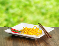 Egg noodles on nature background Royalty Free Stock Image