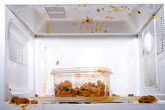 Food exploded. In microwave oven Royalty Free Stock Photo