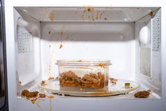 Food exploded. In microwave oven Royalty Free Stock Image