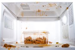 Food exploded. In microwave oven Stock Image
