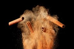 Free Food Explosion With Cinnamon Sticks And Powder Royalty Free Stock Image - 140216076