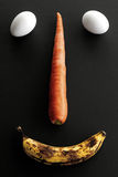 Food face. Face made out of eggs, banana and carrot Royalty Free Stock Photo