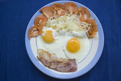 Food Face. Lunch in creative mode whit eggs bacon tomate and soia Royalty Free Stock Photo