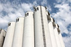 Food factory. Grain silos at a vegetable oil factory in France. Food production industry royalty free stock image