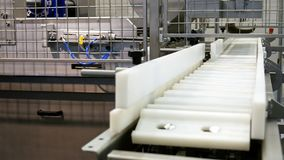Food factory automated robotic conveyor line royalty free stock image