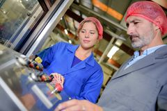 Food factory machine operator. Man royalty free stock photos