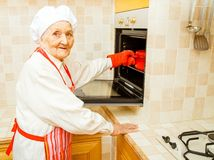 Food for family. Grandmother at home preparing food in the kitchen stock images