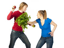 Food fight. An adult couple fighting for fun with different vegetables Royalty Free Stock Images