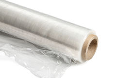 Food film. Roll of wrapping plastic stretch film. Close-up. Isolated on white background. With clipping path Stock Image