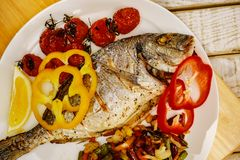 Food fish fresh dorado, meal seafood dinner,  delicious. Food fish fresh dorado, meal seafood dinner with vegetables,  delicious royalty free stock photo