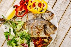 Food fish fresh dorado, meal seafood dinner,  diet gourmet. Food fish fresh dorado, meal seafood dinner with vegetables,  diet gourmet royalty free stock images
